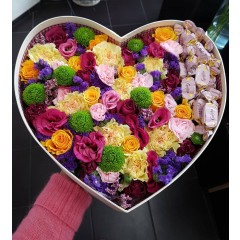 Flower composition in heart box with Geisha candies