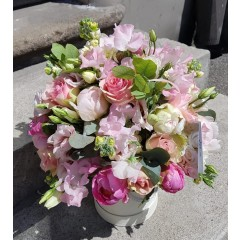 Composition of peony, roses and matthiola flowers in a box